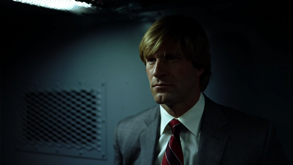 Harvey Dent in van in Dark Knight